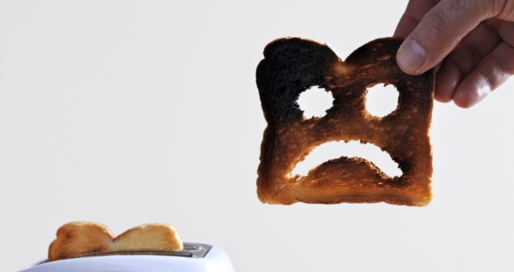 Burnt toast with a sad face to display Facebook Marketing mistakes