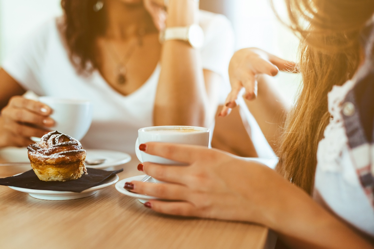 women discussing business over coffee.jpg